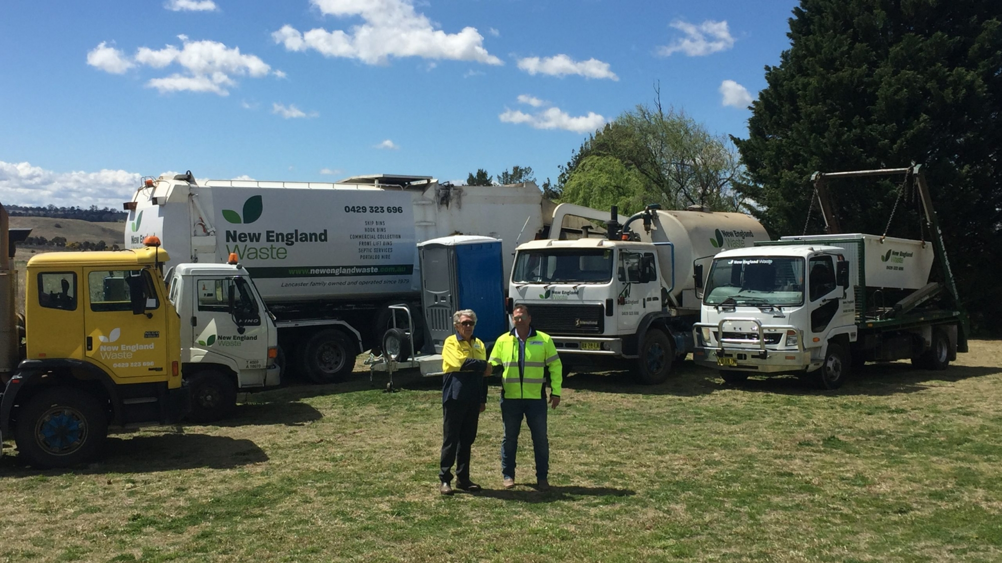 Malcolm and Howard Lancaster from New England Waste with their fleet of waste removal vehicles